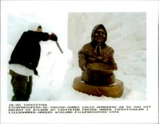 """Gomez Lollo Humberto is about to hack the image of the statue """"Prayer"""" during the Ice Hockey Festival in Lillehammer"""