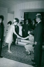 Queen Sofia shaking hands with a woman.
