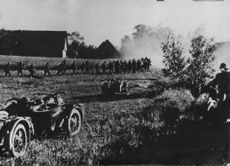 German Motorcycle Patrols advanced on a Russian village encountered resistance and seen here on offensive.  - Jul 1941