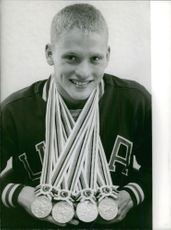 A player show casing his medals wearing on his neck.  Taken - 27 Oct. 1964