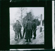 Norweigan soldiers gathered and looking at something. Photo taken in April 1940.