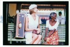 A woman in white dress with an elder woman.