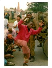 African National Congress Supporters dance.
