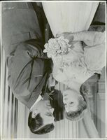 """Greer Garson and Walter Pigeon in """"Flowers in Shadow""""."""