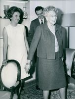 A photo of Maria del Pilar and her husband Luis Gomez-Acebo at the back smiling.