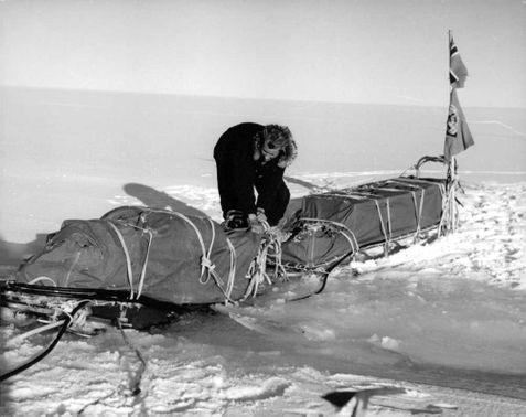 Man saving his stuff atop a sled from the melted ice.  - Oct 1962
