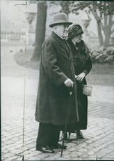 Charles Cripps with an old woman standing together.