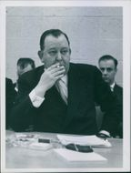 Secretary-General Trygve Lie smoking during the press conference. 1950.