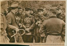 "Soviet soldier standing and meeting with another group of soldiers.  ""Russian soldier"""