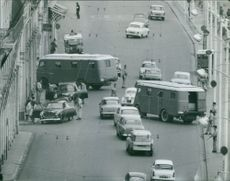 Policemen put a check point on the road to check on vehicles in Algeria.  Taken - May 1962