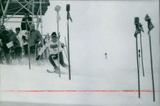 Marielle Goitschel crossing poles while skiing, 1968.