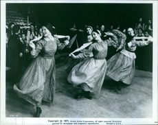 Rosalind Harris, Neva Small and Michele Marsh all dancing in a row in a scene from the film 'Fiddler On The Roof', 1971.