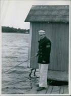 Man standing and fishing. 1944