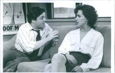"Nathan Lane and Elizabeth Perkins in a scene from a 1991 American romantic comedy film, ""He Said, She Said."""