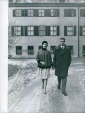 Duke and Duchess of Württemberg, Carl and Diane walking hand in hand together. 1959.