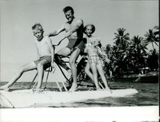 Kirk Douglas with his wife Anne and sons Peter and Eric. 1964.