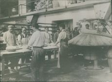 People working together in the kitchen during First World War, 1936.