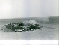 A camp being attacked and exploded.