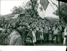 People of Vietnam protesting and carrying flags.