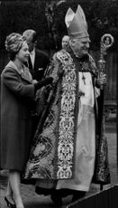 Queen Elizabeth together with the Archbishop on his way to a traditional Mother's Day ceremony in Canterbury Cathedral
