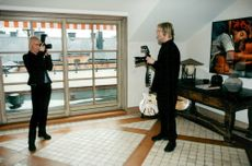 Marie Fredriksson and Per Gessle in Roxette photograph each other