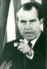 President Richard Nixon points to a reporter during a press conference in Washington
