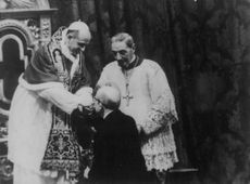 Pope Paul VI being greeted by his follower.