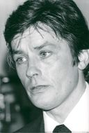"Actor Alain Delon celebrates the end of the filming of the movie ""Airport '79"" at Plaza Athenee"