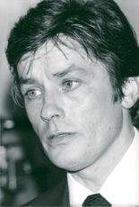 """Actor Alain Delon celebrates the end of the filming of the movie """"Airport '79"""" at Plaza Athenee"""