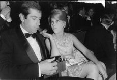 Roger Vadim with Jane Fonda at a function.