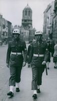 Two M.P guards patrol the streets. 1944.