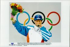 Russian skater Larissa Lazutina but his gold medal during the Winter Olympics 1998