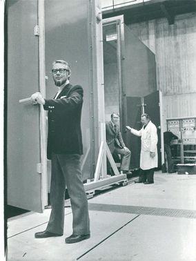 "Professor Ingemar Höglund opens the door to an ""optional climate"" in the simulator. In the background Arne Elmroth and Curry Nyström"