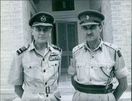 A photo of military personnel involve in Operation Vantage in Kuwait standing in front of the door of the building.