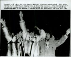 Medalists in downhill skiing Leonard Stock, Peter Wirnsberger and Steve Podborski at the awards ceremony during the 1980 Winter Olympics