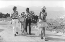 Claudia Cardinale walking, with her son Patrizio Cardinale and friends.