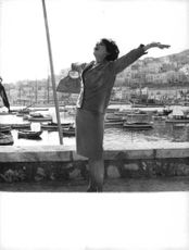 Pascale Petit enjoying the breeze with arms outstretched, in Athens