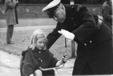 giving training of a small child.