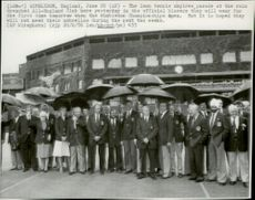 The staff lined up in the rain before the evening parade at the Wimbledom arena.