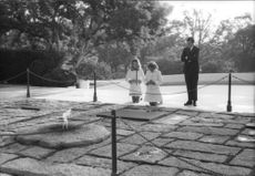 """Women praying in front of memorial of Robert Francis """"Bobby"""" Kennedy."""