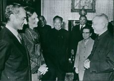 The Shah and Empress of Iran (left) receiving Chinese Vice Premiere Li Hsien-nien and his wife, Lin Chai-mei, in Teheran. 1975.