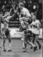 """Hammarbyspelers hug over each other after one of the goals against Brage. Thomas Dennerby rides on Micke Andersson next to Klas Johansson and """"Putte"""" Ramberg"""