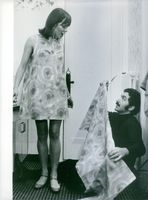 Paco Rabanne assisting the woman.