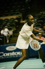 Venus Williams is serving the ball during the match against Shaun Stafford.