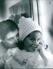 Sacha Distel praising his wife´s beauty.  Photo taken Jan 28, 1963