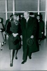 Margrethe II  and Don Jaime de Borbon walking and facing each other while talking, 1972.