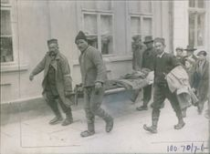 A wounded man being taken to  hospital by the soldiers during Balkan wars, 1912.
