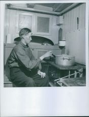 A man cooking in the kitchen. 1945