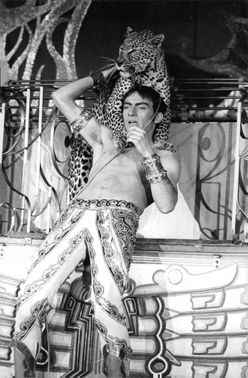 Man with leopard having a show  in Moulin Rouge.