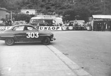 Rally car number 303 with its driver parked on the side during Monte Carlo racing event.  - Jan 1962